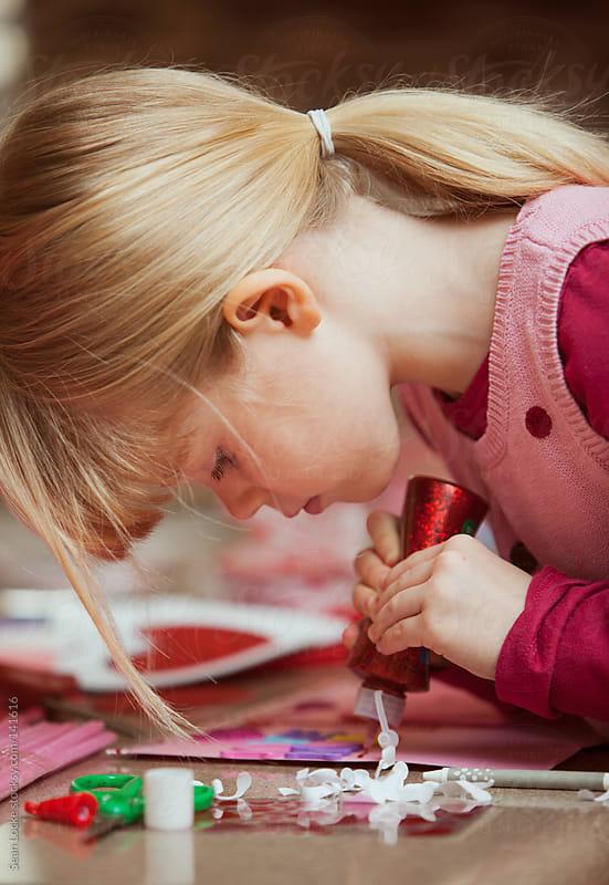 Valentine: Putting Glitter Glue on a Valentine by Sean Locke for Stocksy United