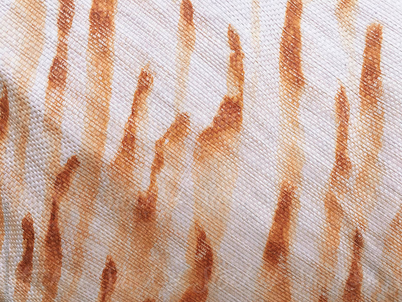 Rust stains on tarpaulin fabric, close up by Paul Edmondson for Stocksy United