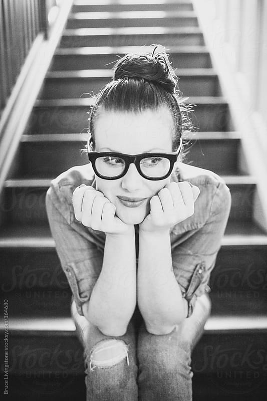 Portrait of a woman on the stairs. by Bruce Livingstone for Stocksy United