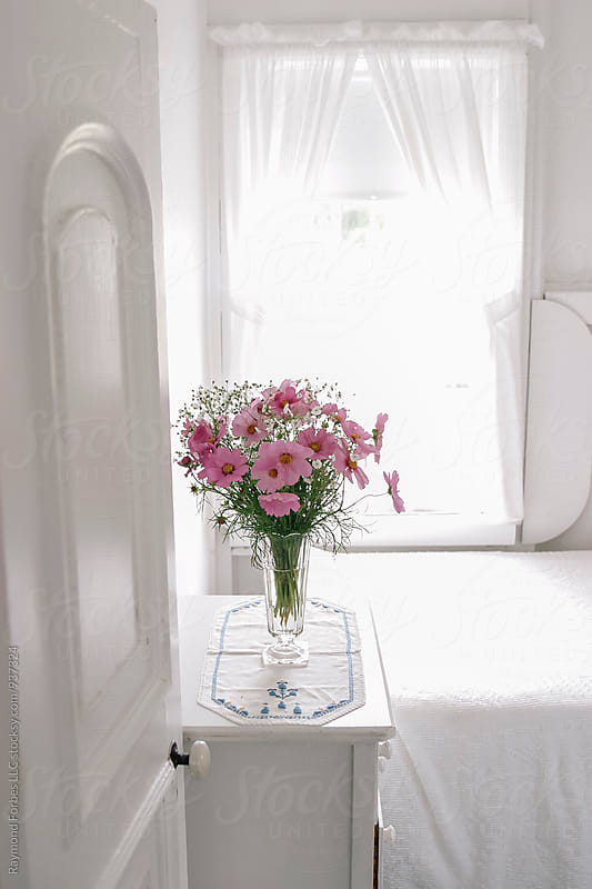 Flowers in the Bedroom at Summer Cottage by Raymond Forbes LLC for Stocksy United