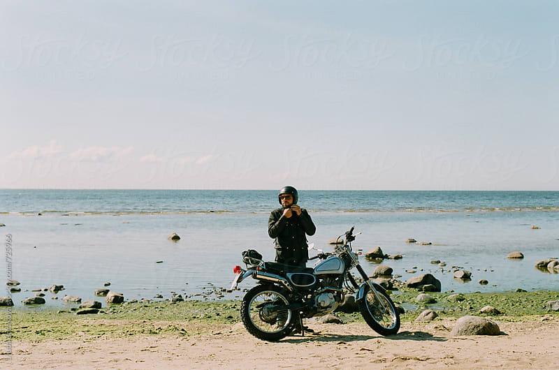Man wearing motorcycle helmet  by Liubov Burakova for Stocksy United