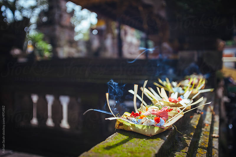 Traditional Balinese offerings outside a Hindu temple by Adrian Seah for Stocksy United