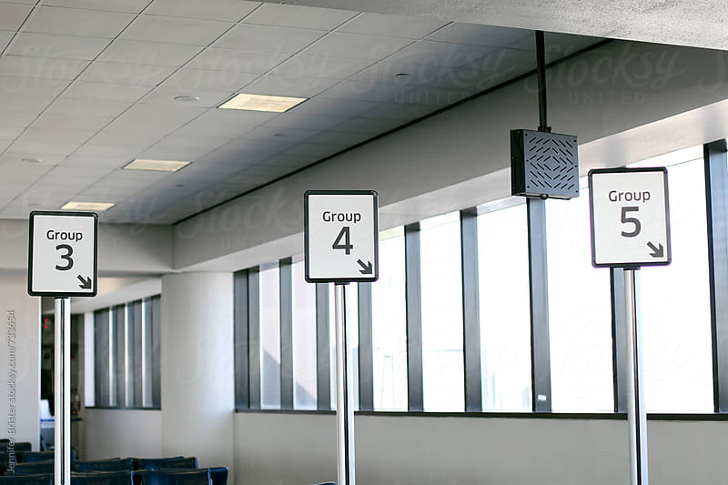 Signs at airport by Jen Brister for Stocksy United