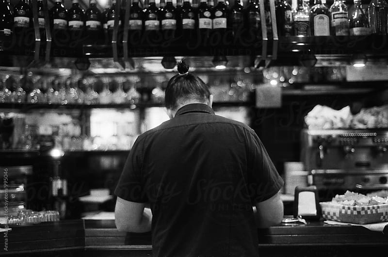 A back portrait of a man in the bar by Anna Malgina for Stocksy United