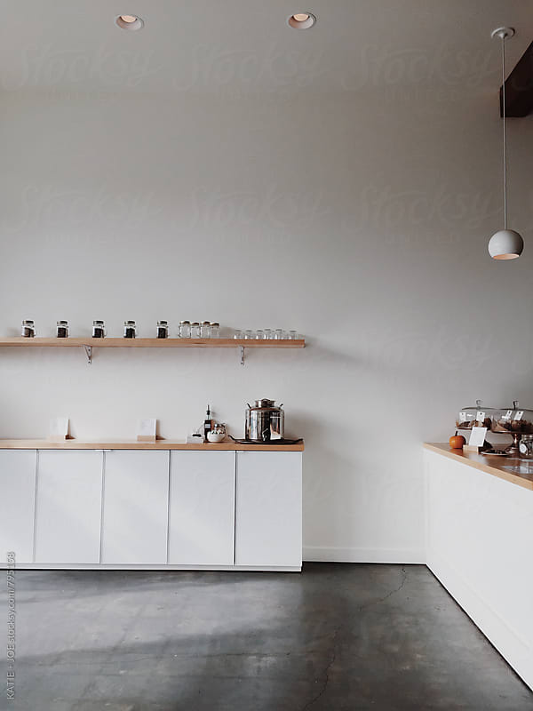 Modern white cafe by KATIE + JOE for Stocksy United