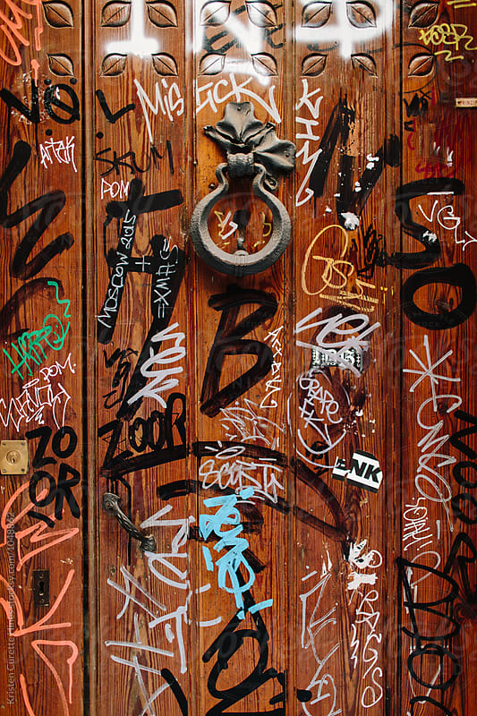 A door with markings & Graffiti in Barcelona, Spain by Kristen Curette Hines for Stocksy United