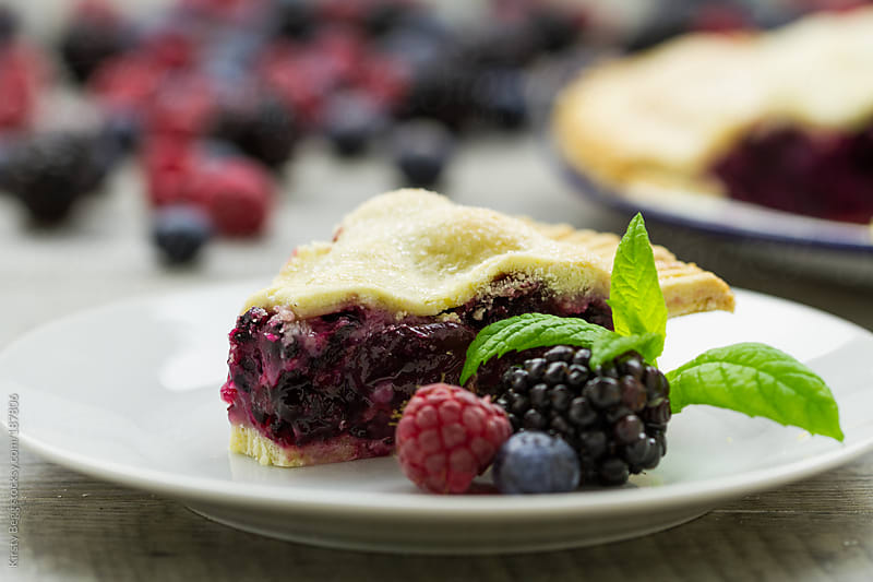Slice of berry pie by Kirsty Begg for Stocksy United