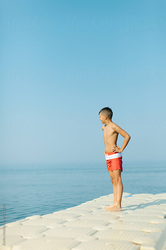 Young boy looking over the sea by Zocky for Stocksy United