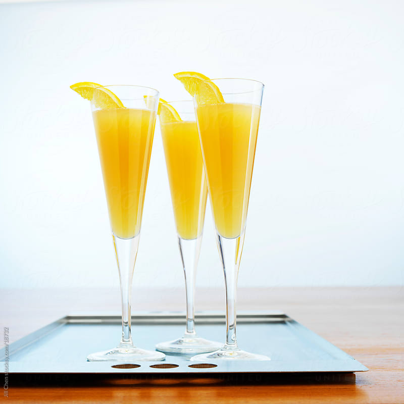 Champagne & Orange Juice by Jill Chen for Stocksy United