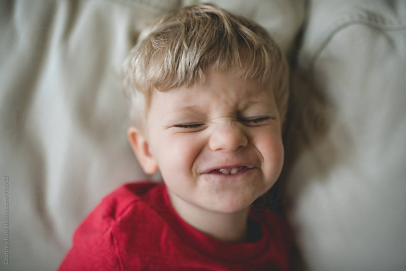 Boy making funny face by Courtney Rust for Stocksy United
