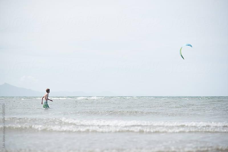 Boy alone on the beach by Léa Jones for Stocksy United