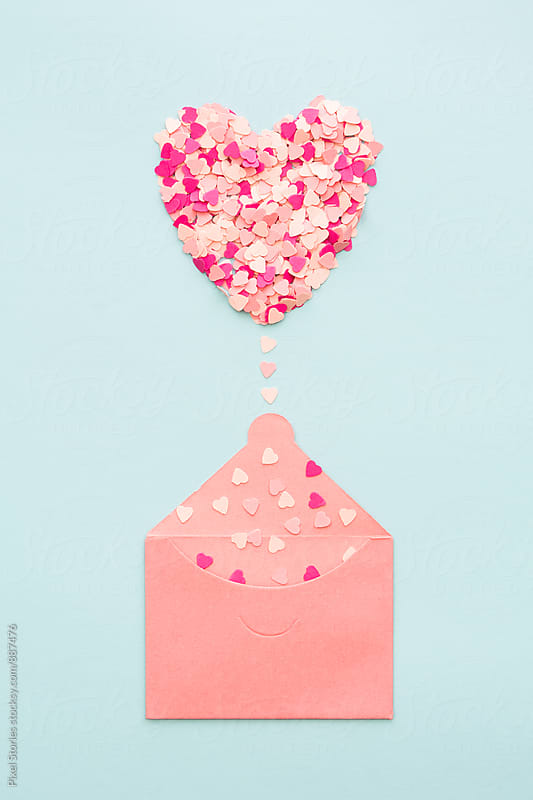 Pastel heart emerging from envelope by Pixel Stories for Stocksy United