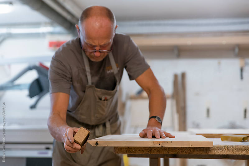 Carpenter working in workshop by Robert Kohlhuber for Stocksy United