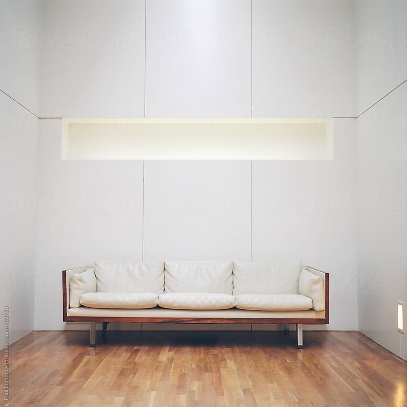 Retro leather couch in modern, minimalist hotel lobby by Paul Edmondson for Stocksy United