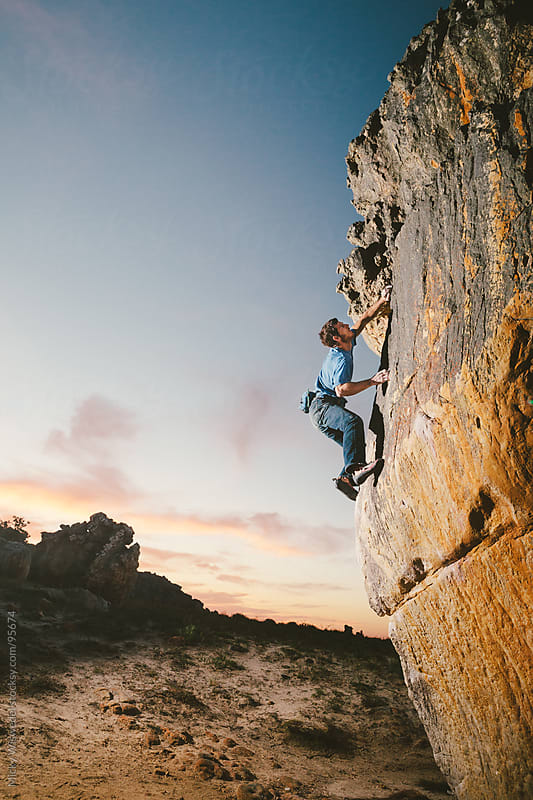 Young Man Rock Climbing (bouldering) by Micky Wiswedel for Stocksy United