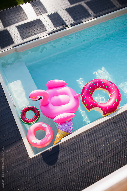 Summer floats in the pool by Jovana Rikalo for Stocksy United