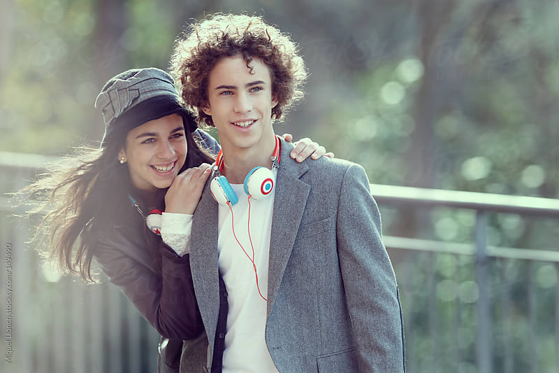 Teen couple in the city park by Miquel Llonch for Stocksy United