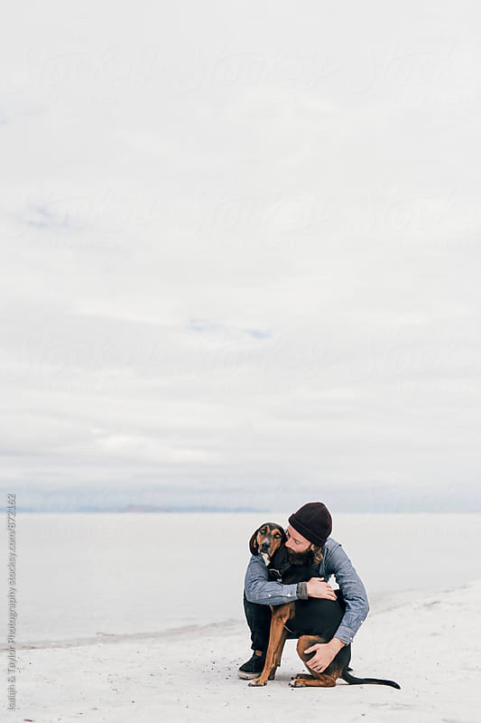Man and Dog Hugging by Isaiah & Taylor Photography for Stocksy United