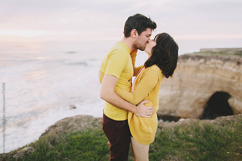 cute couple on sea cliffs by Dylan M Howell Photography for Stocksy United