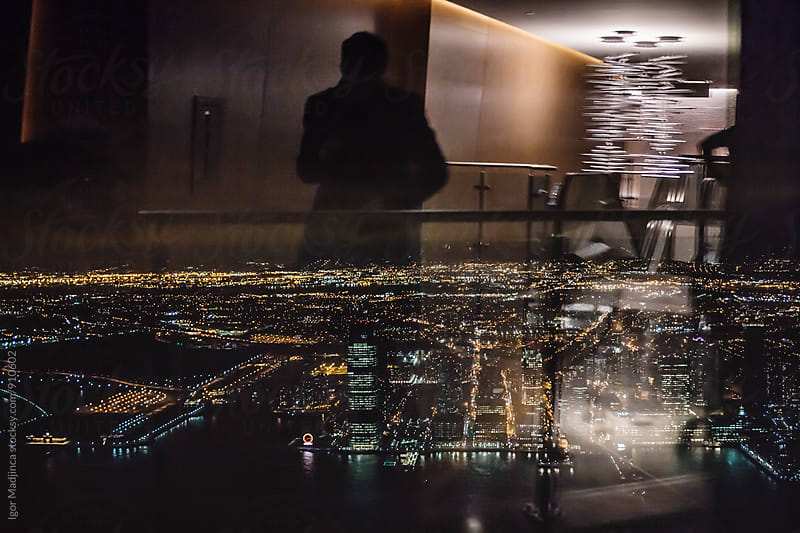 reflections in the window,Night cityscape,view from 102 floor on the New York streets and buildings by Igor Madjinca for Stocksy United