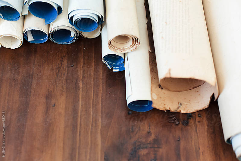 An assortment of antique scrolls on a table. by Holly Clark for Stocksy United