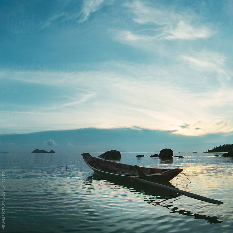 Boat at Sunset by VISUALSPECTRUM for Stocksy United