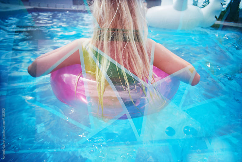blonde girl in floaty with colors on top with double exposure by wendy laurel for Stocksy United