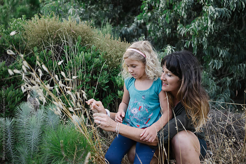Mom and daughter exploring the wild by Bruce and Rebecca Meissner for Stocksy United