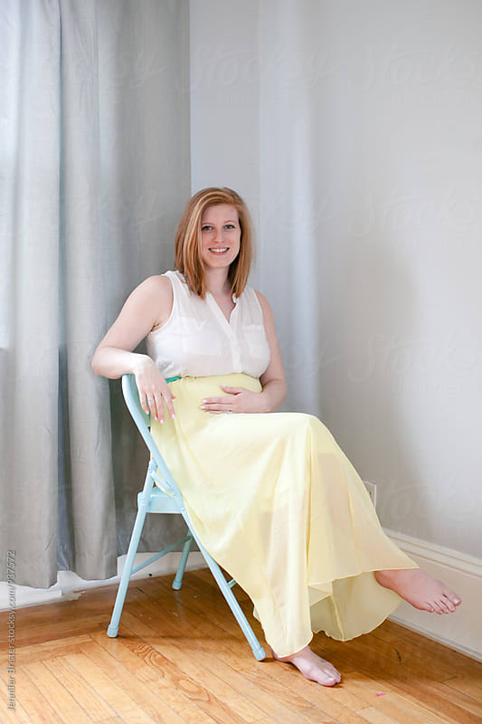 Lovely pregnant woman sitting in chair by Jennifer Brister for Stocksy United