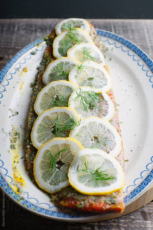 Series showing the making of salmon gravlax from start to finish. Side of salmon with lemon. by Darren Muir for Stocksy United