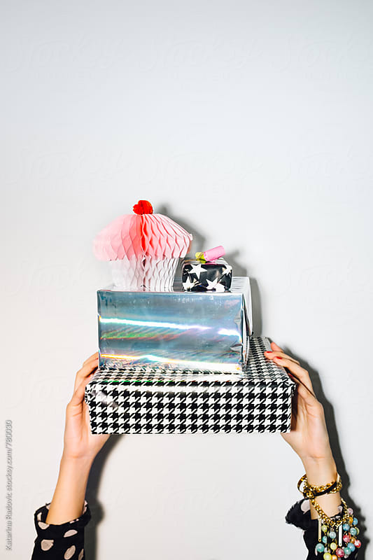 Woman Holding Shiny Party Presents by Katarina Radovic for Stocksy United
