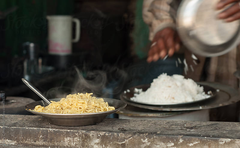 A hot dish of noodles cooked at a street stall in India by Andy Campbell for Stocksy United