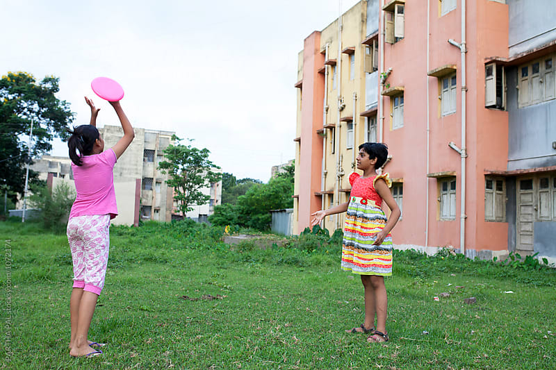 Teenage girl playing with flying disc at outdoor by PARTHA PAL for Stocksy United
