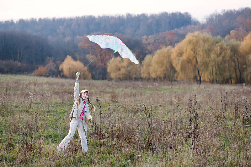 Girl with a kite  by Sveta SH for Stocksy United