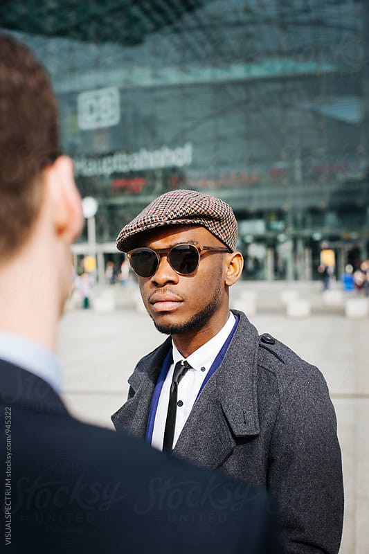 Good-Looking Young Black Businessman Meeting With Caucasian Businessman on Sunny Day by Julien L. Balmer for Stocksy United