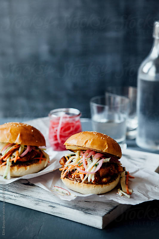 Grilled paprika chicken burger by Ellie Baygulov for Stocksy United