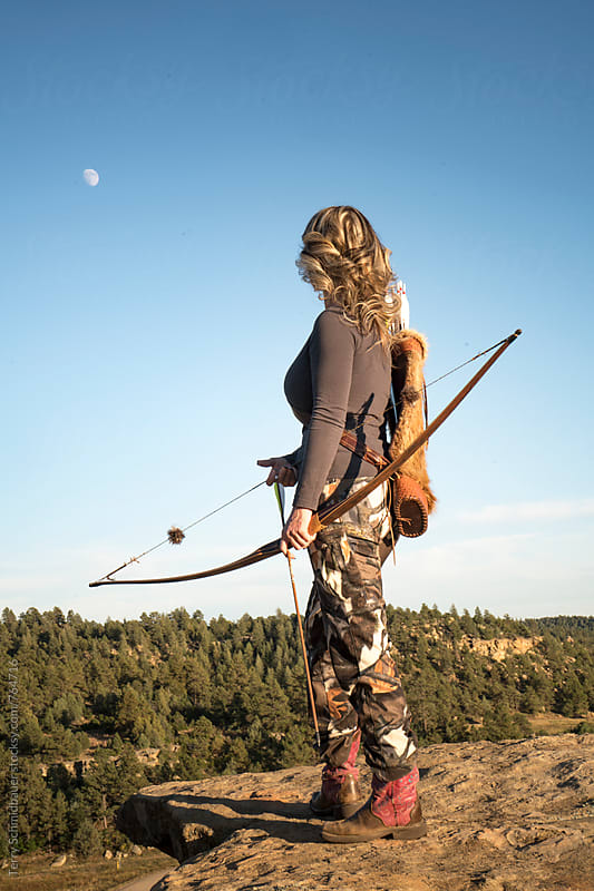 Female Bow Hunter by Terry Schmidbauer for Stocksy United