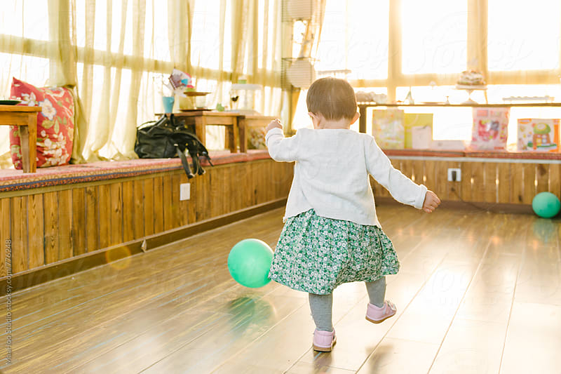 Toddler girl playing with balloon by Maa Hoo for Stocksy United
