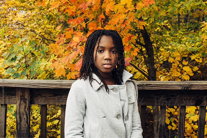 African American girl on a nature walk in the fall by Gabriel (Gabi) Bucataru for Stocksy United