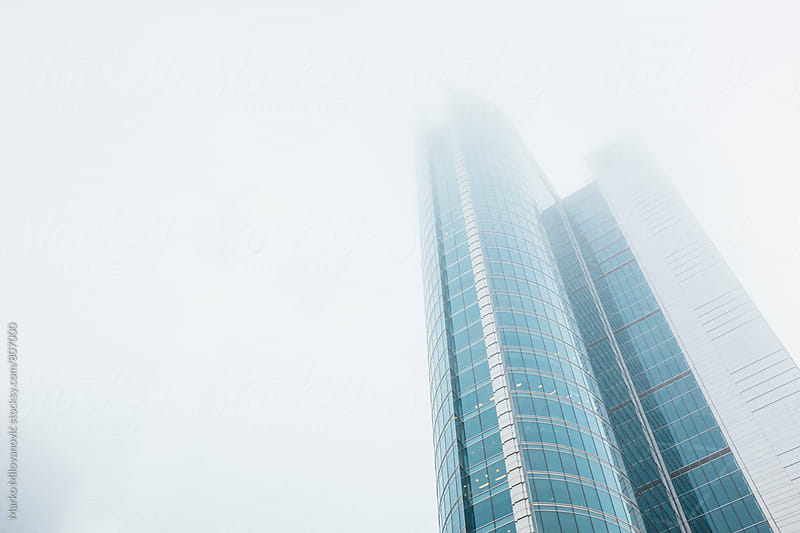 Modern building in fog by Marko Milovanović for Stocksy United