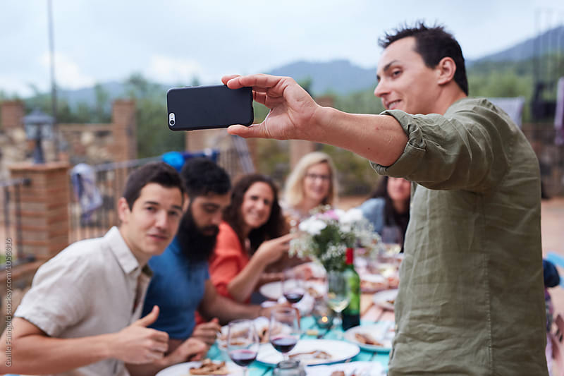 Friends photographing using cell phone by Guille Faingold for Stocksy United