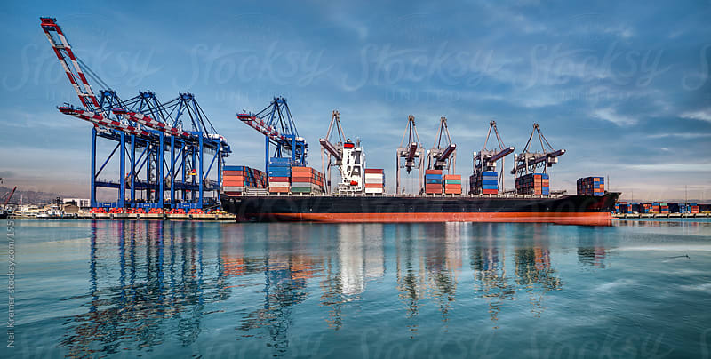 Container Vessel sitting in port by Neil Kremer for Stocksy United