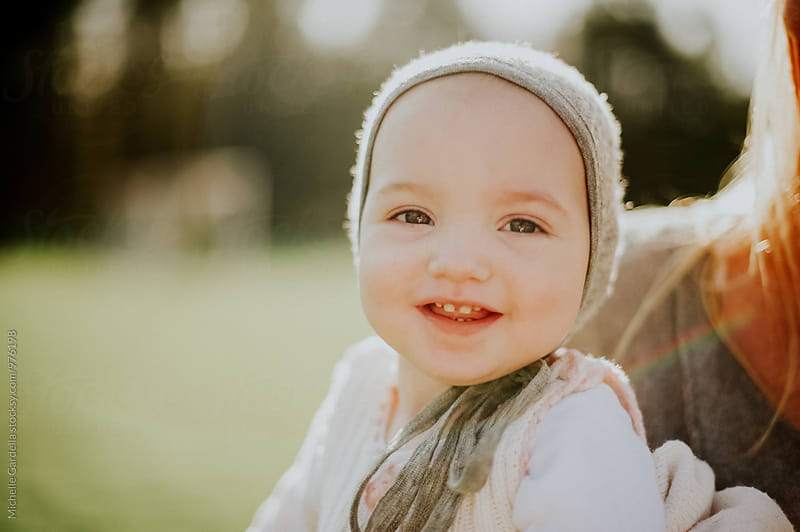 baby in the sunshine by Michelle Gardella for Stocksy United