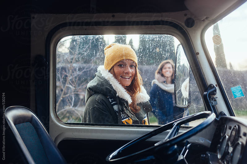 Two girls on a winter road trip by Good Vibrations Images for Stocksy United