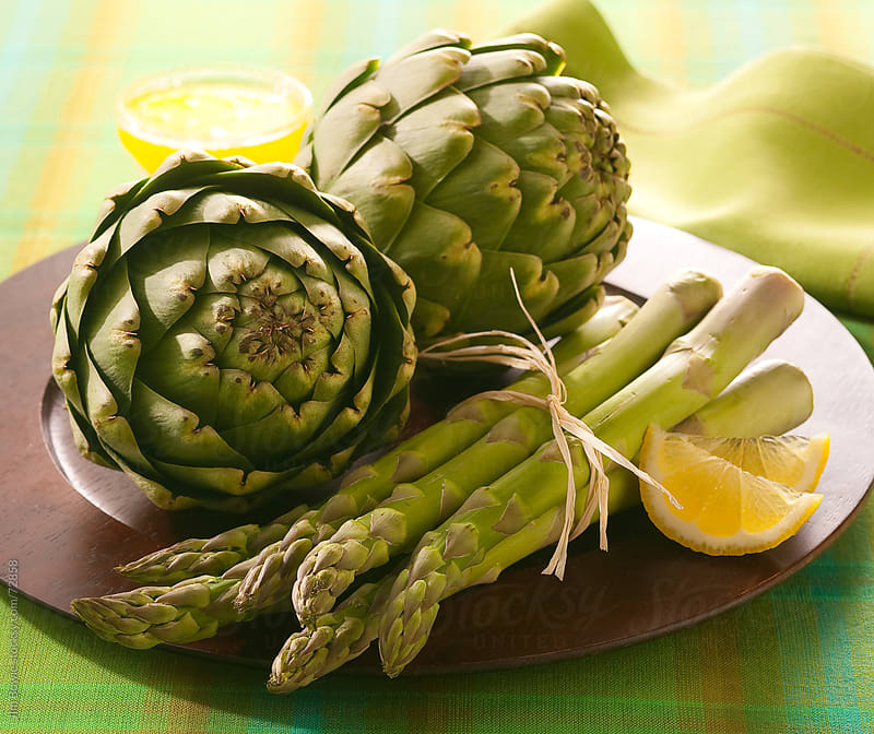 Fresh asparagus with artichokes by JIm Bowie for Stocksy United