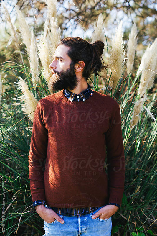 Modern bearded man in the forest. by BONNINSTUDIO for Stocksy United