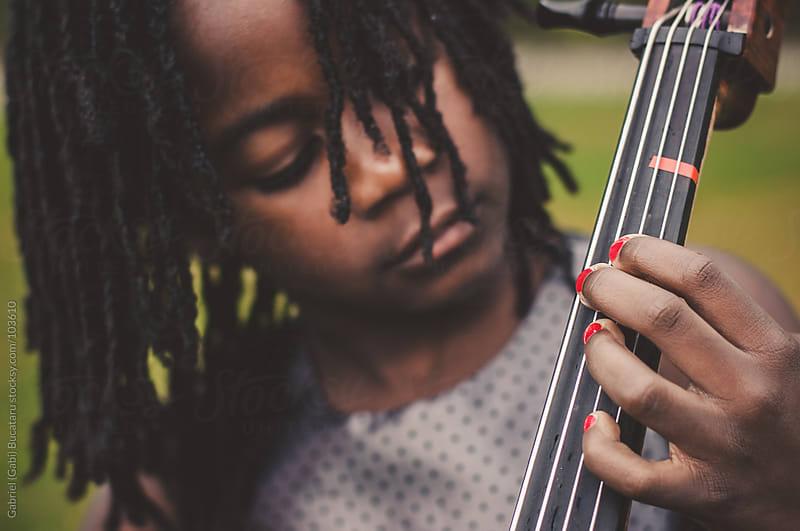 Girl playing cello by Gabriel (Gabi) Bucataru for Stocksy United
