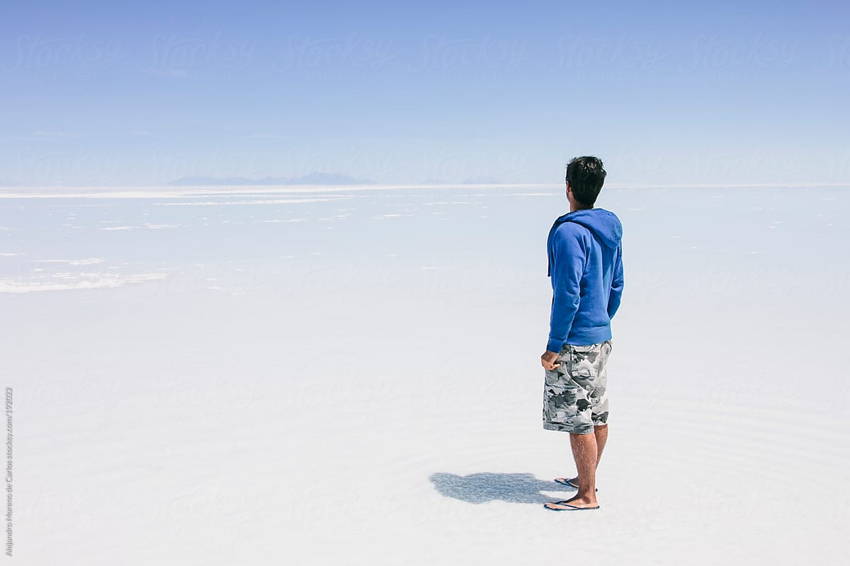 Young Man Facing Back Looking To The Infinite On Uyuni