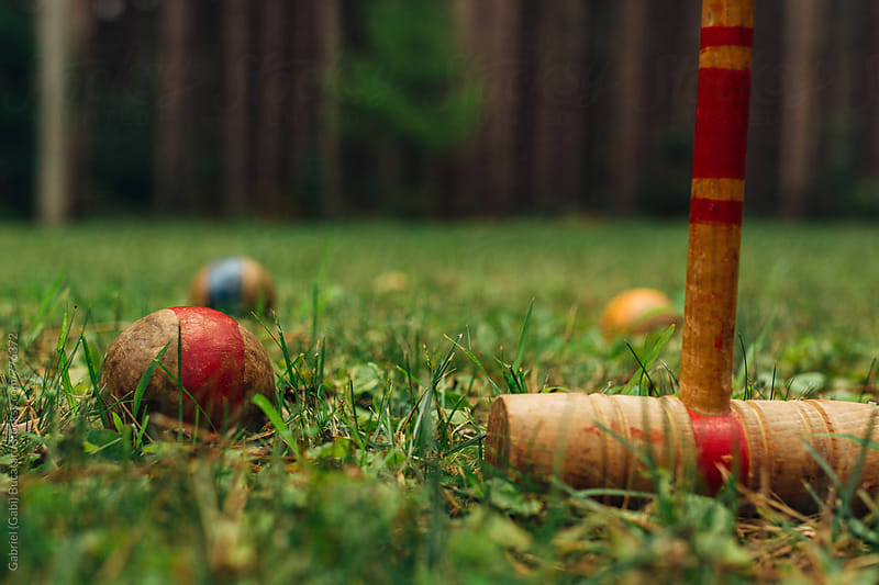 Wooden Croquet Balls and Mallet on a Lawn by Gabriel (Gabi) Bucataru for Stocksy United