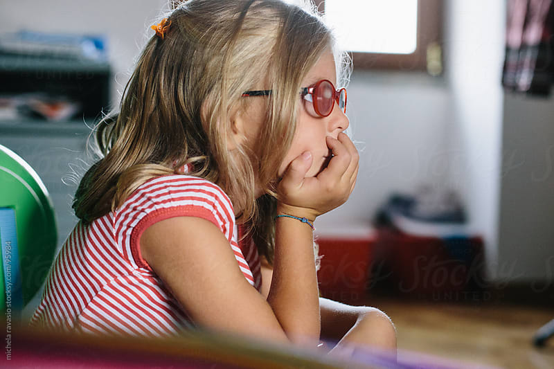 Portrait of a little girl thinking. by michela ravasio for Stocksy United